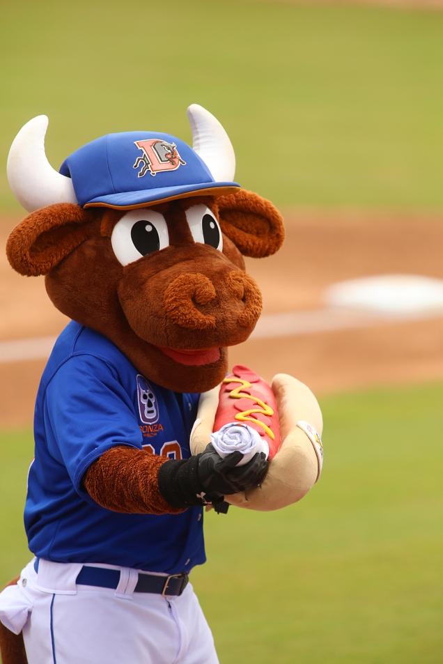 Durham Bulls mascot Wool E. Bull with a hot dog launcher.
