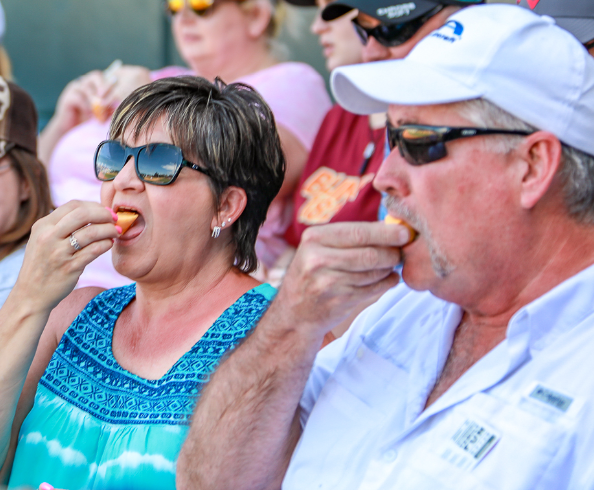 A couple takes part in a fortune cookie promotion with the Jacksonville Jumbo Shrimp.