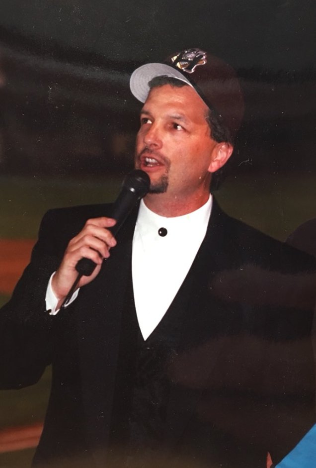 Rick Zolzer talks to the crowd on Opening Night in 1995.